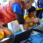 A child playing a computer-based environmental decision game.